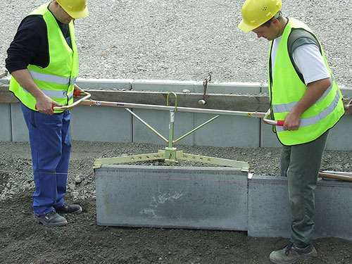 Kerb-Handler being used to lift kerb Paving Solutions