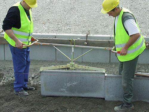 Kerb-Handler being used to lift kerb